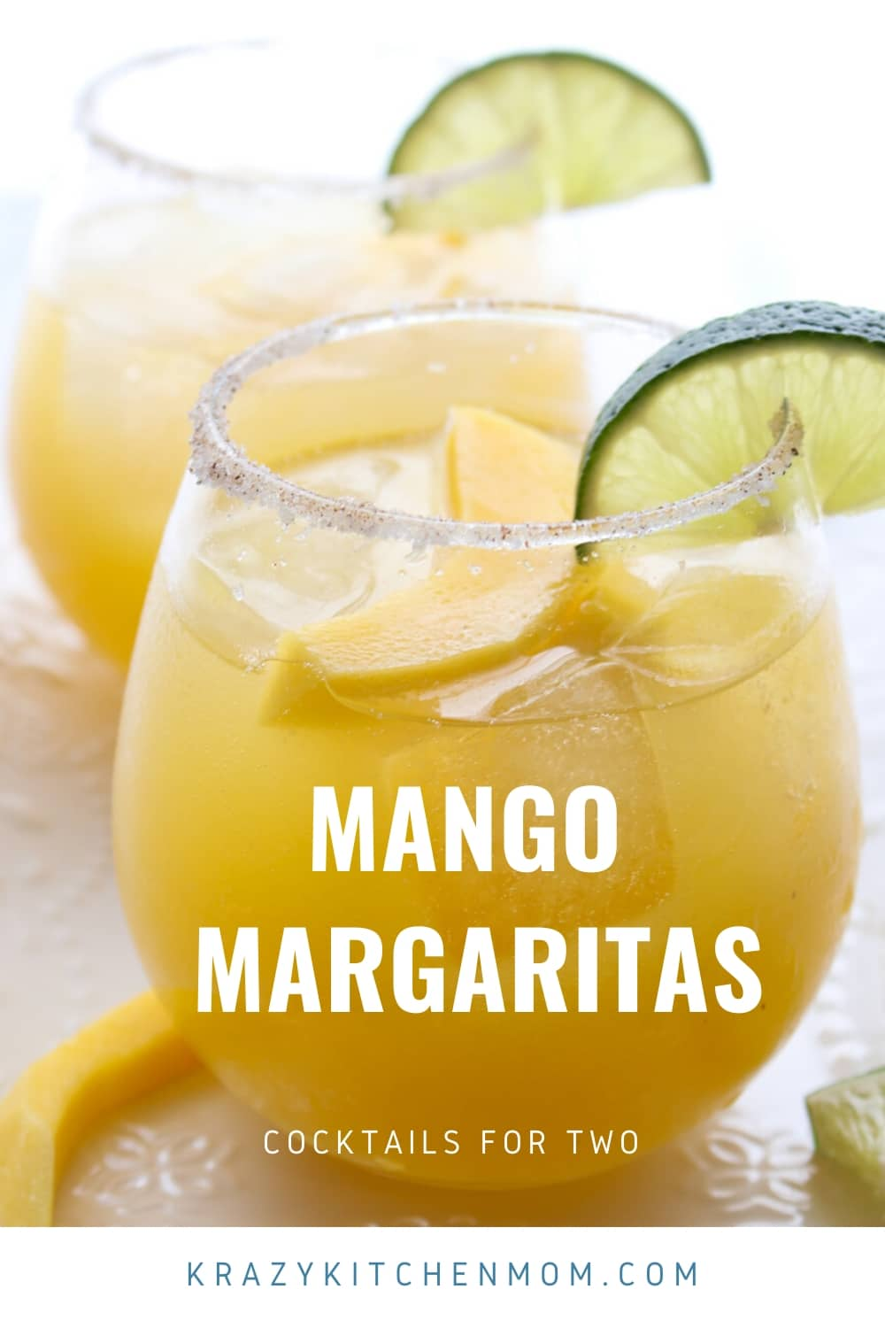 Simple Mango Margaritas are made with tequila, Cointreau, lime juice, and mango nectar. They are sweet, tangy, a  little bit spicy, and refreshing. via @krazykitchenmom