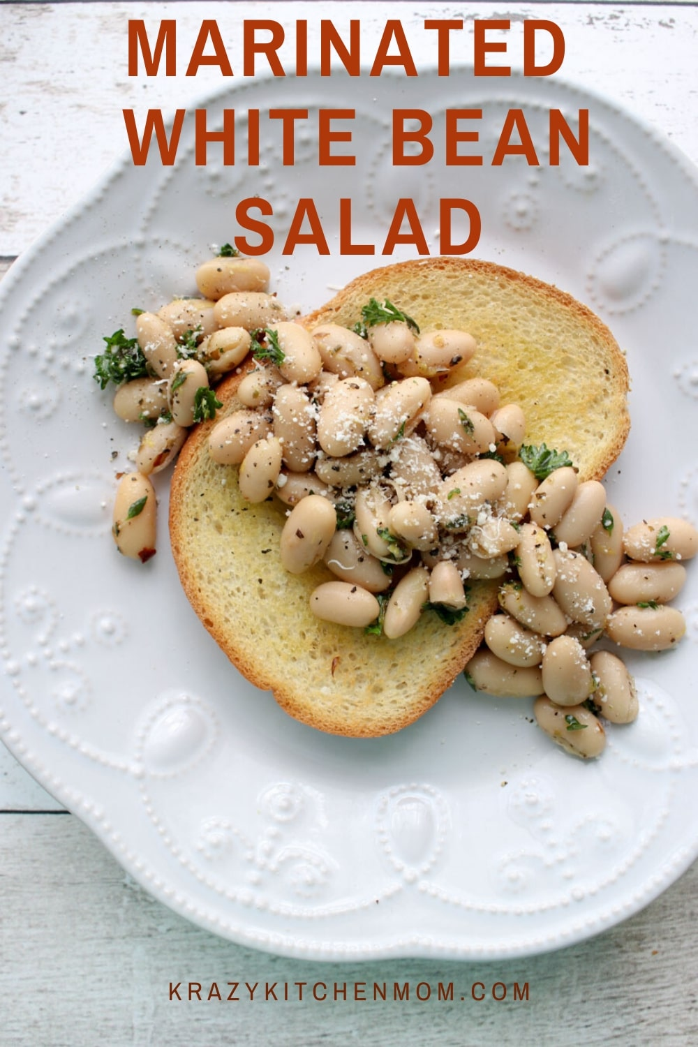 This Marinated White Bean Salad is simple and satisfying and comes together in just minutes. It's a combination of creamy white beans with fresh herbs and olive oil.  via @krazykitchenmom