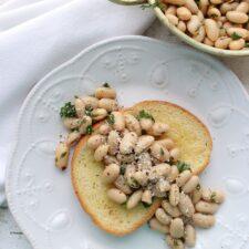 White bean salad on a slice of toast