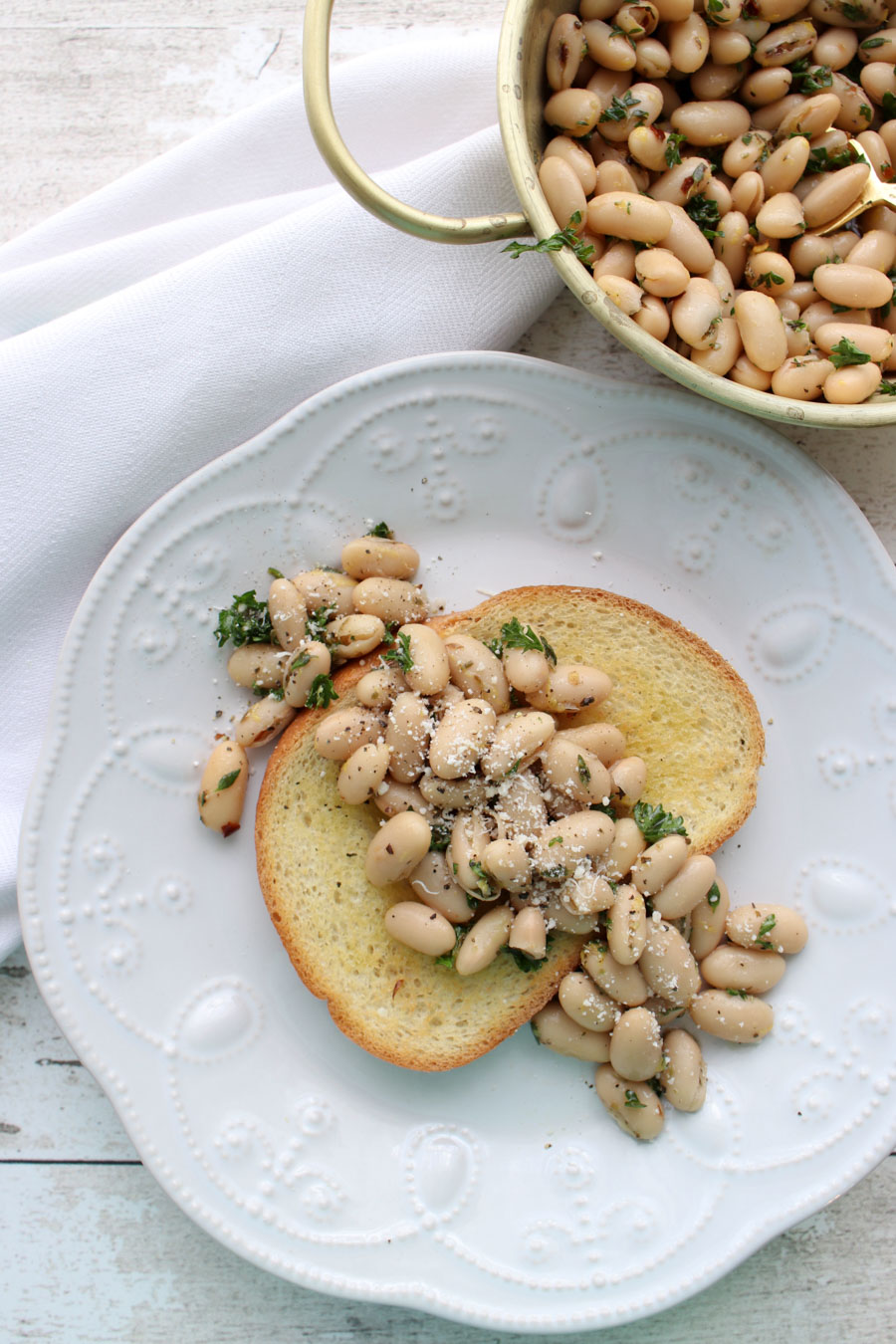 White bean salad on a slice of toast