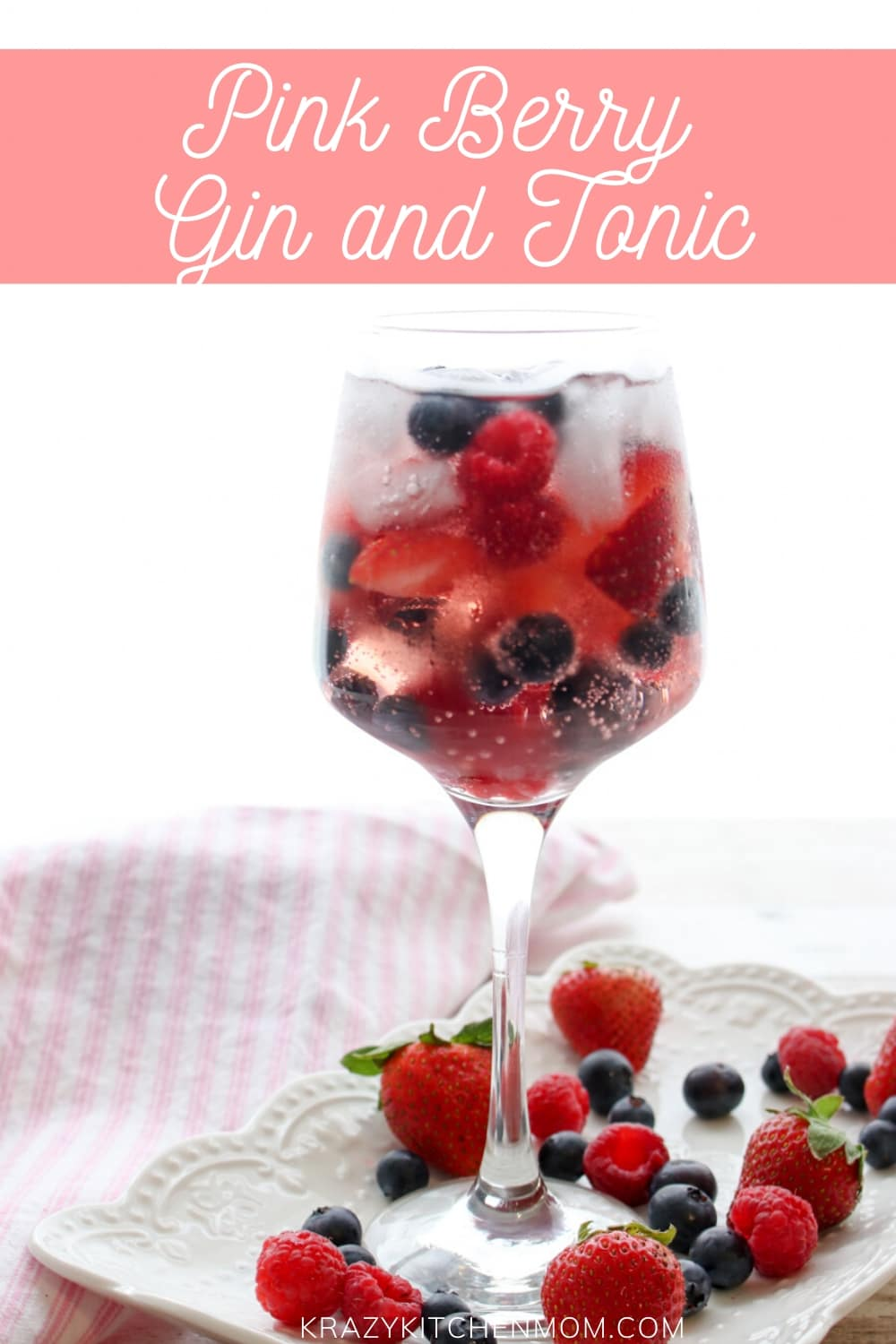 Pink Berry Gin and Tonic is a refreshing cocktail made with Pink Gin and filled with fresh strawberries, raspberries, and blueberries served over ice.  via @krazykitchenmom