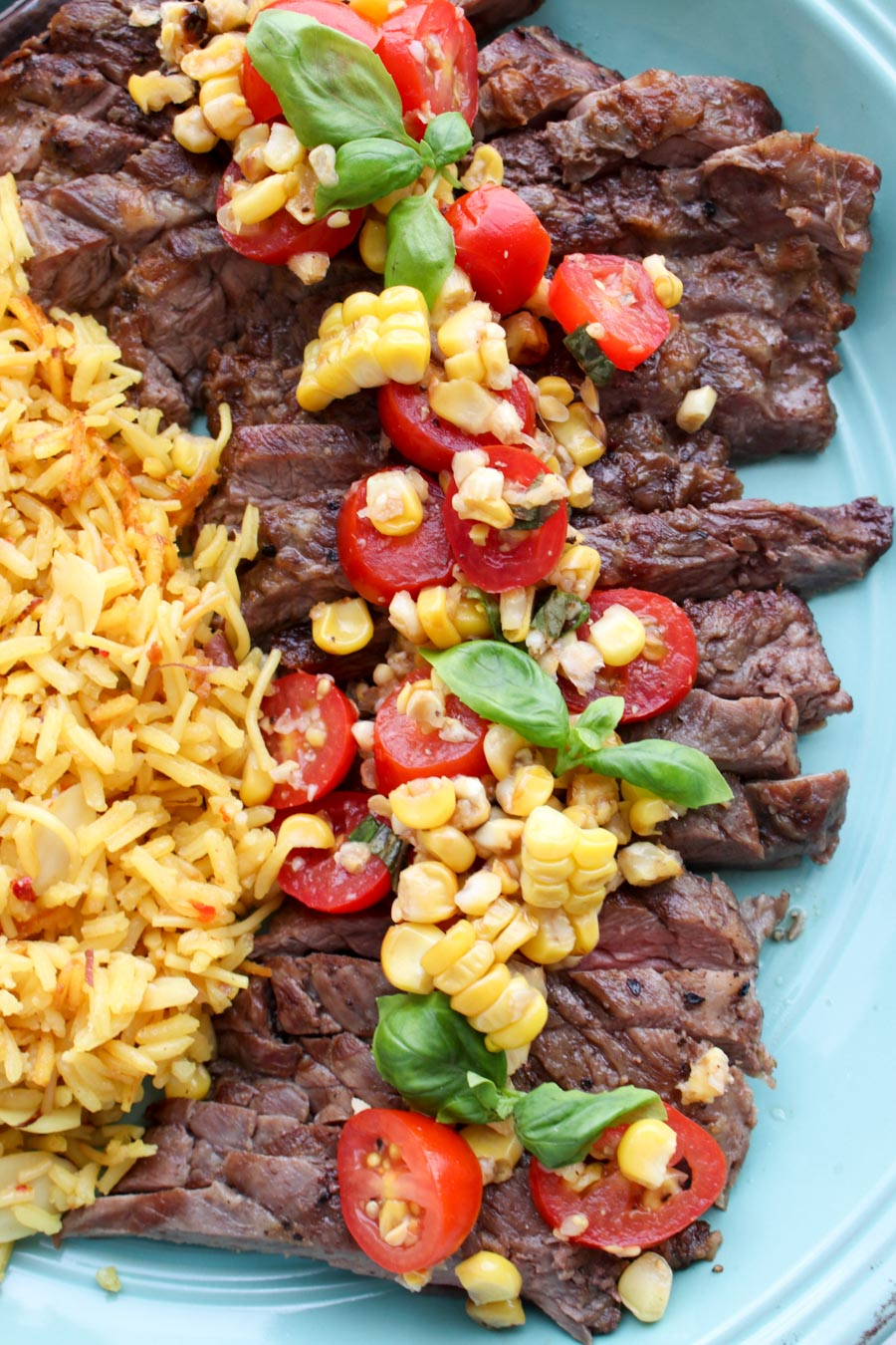 Platter with steak topped with salsa