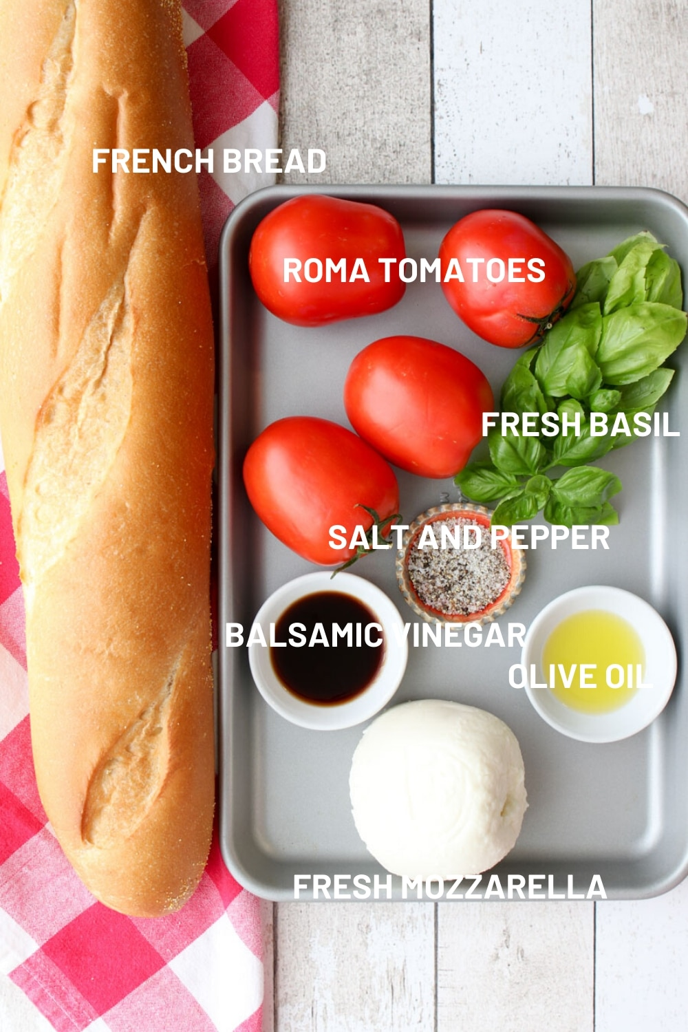 A tray with all of the ingredients to make bruschetta