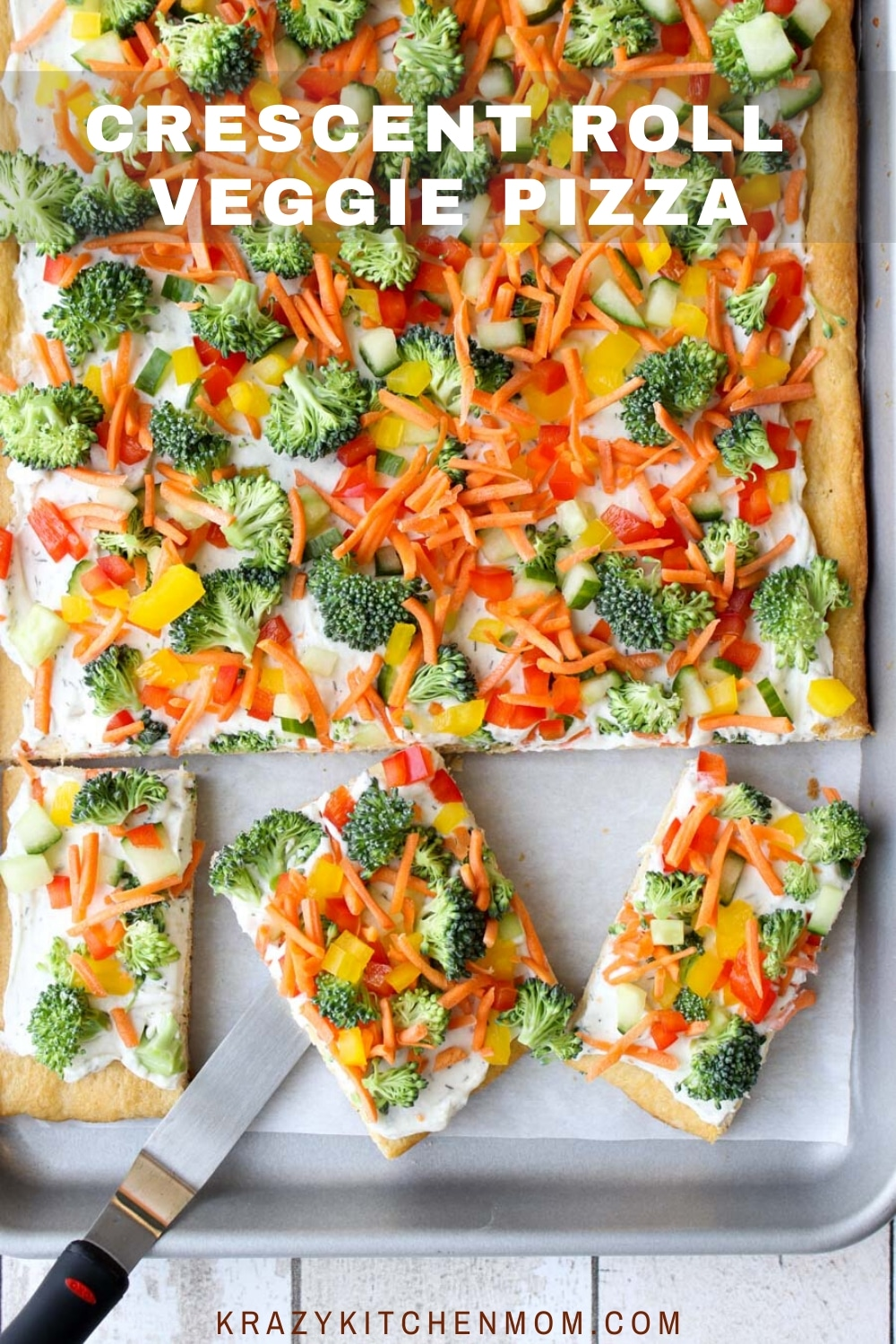 A flakey crust topped with creamy herby dill dip and topped with fresh vegetables. It's perfect for a light lunch or a party appetizer any time of the year. via @krazykitchenmom