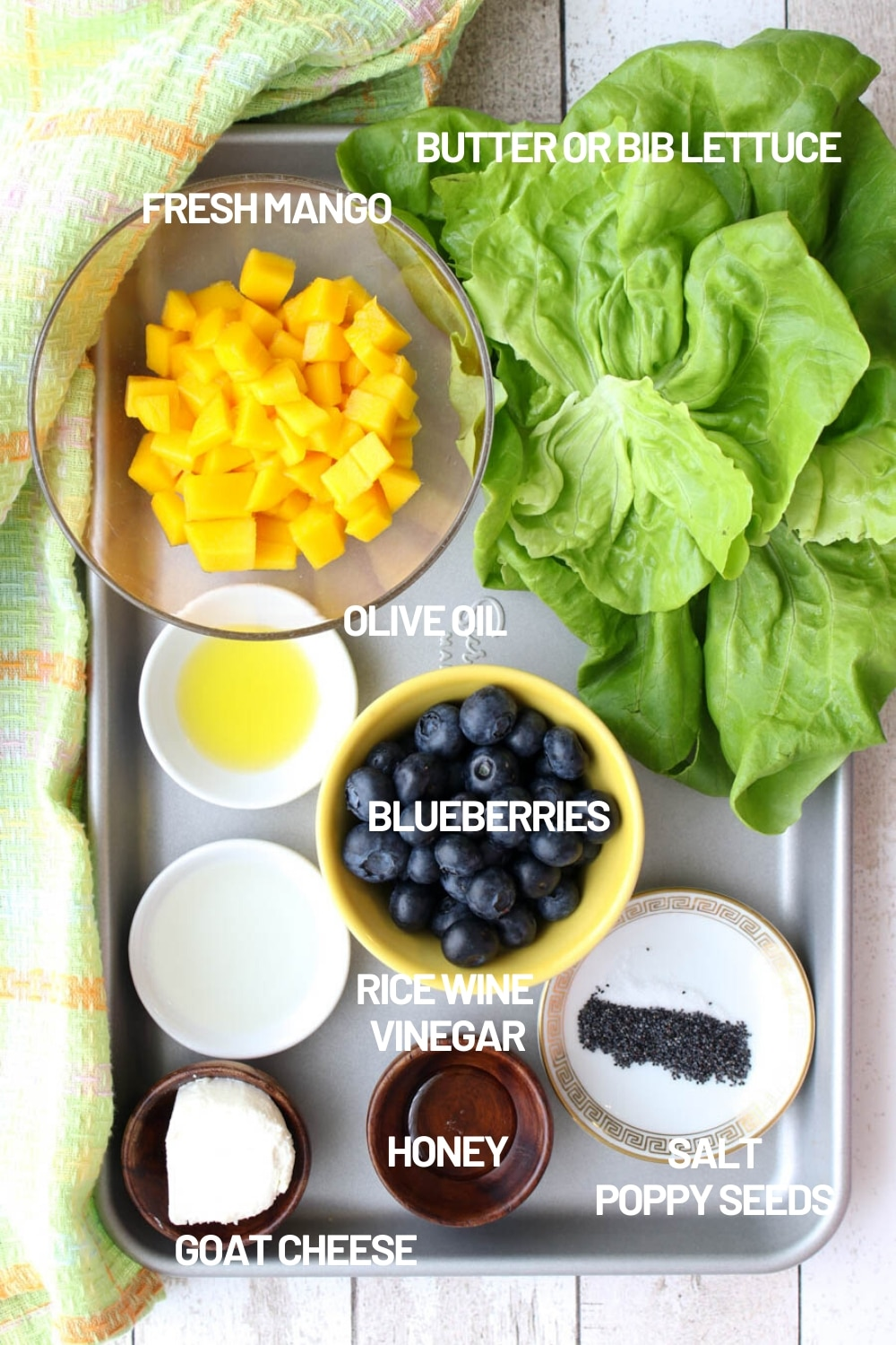 Tray with the ingredients for making mango blueberry salad