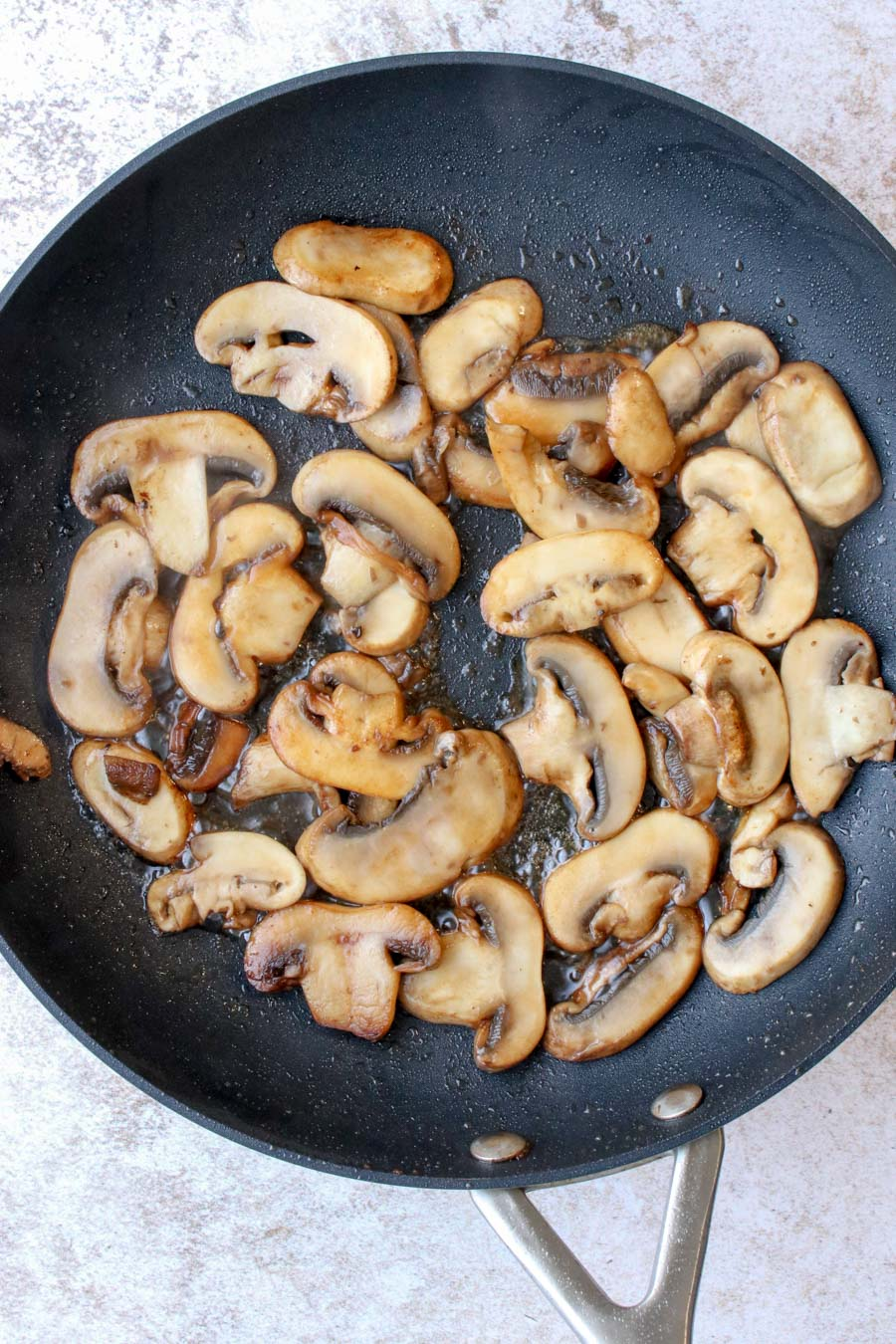 mushrooms cooking in a skillet