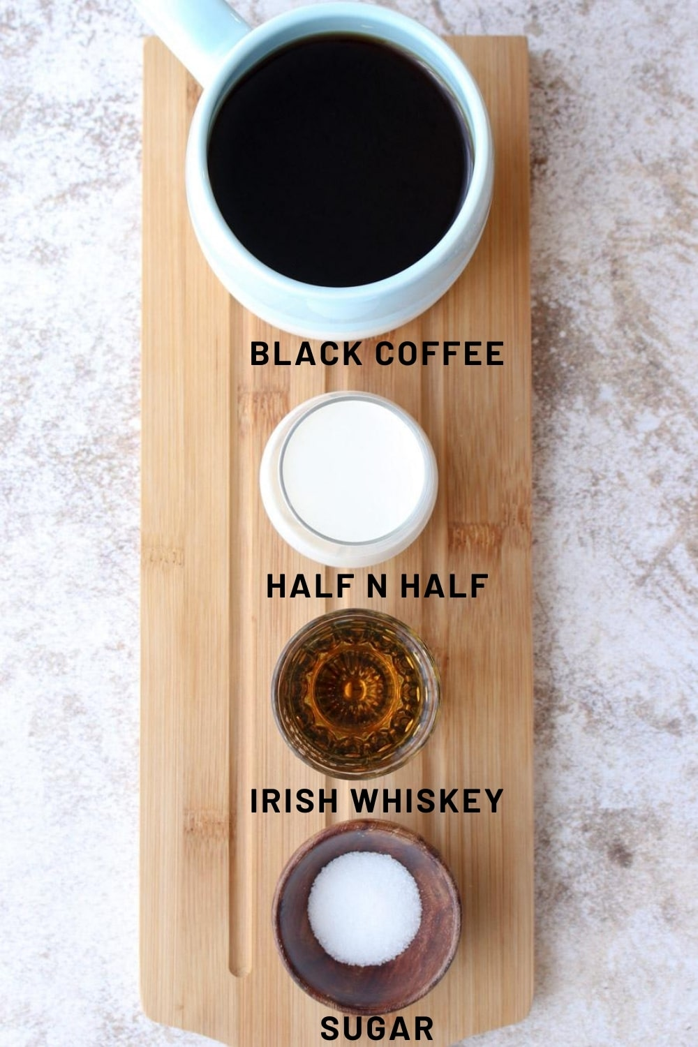Long board with the four ingredients for making iced  Irish coffee