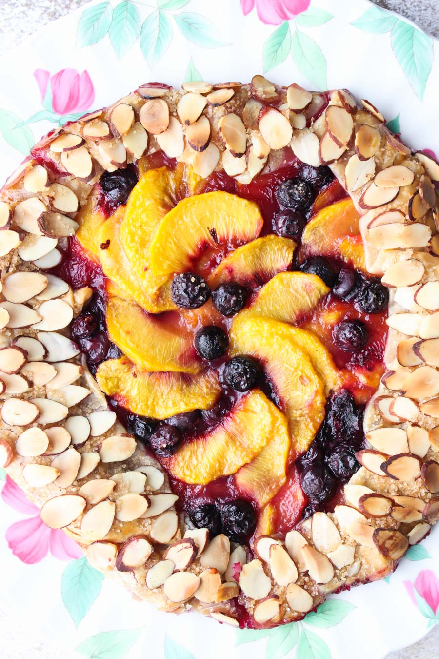 Close up of the baked peach and blueberry galette