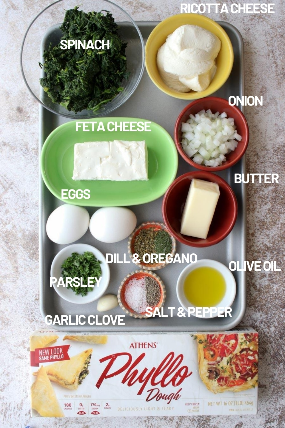 sheet pan with all of the ingredients it takes to make a spinach galette