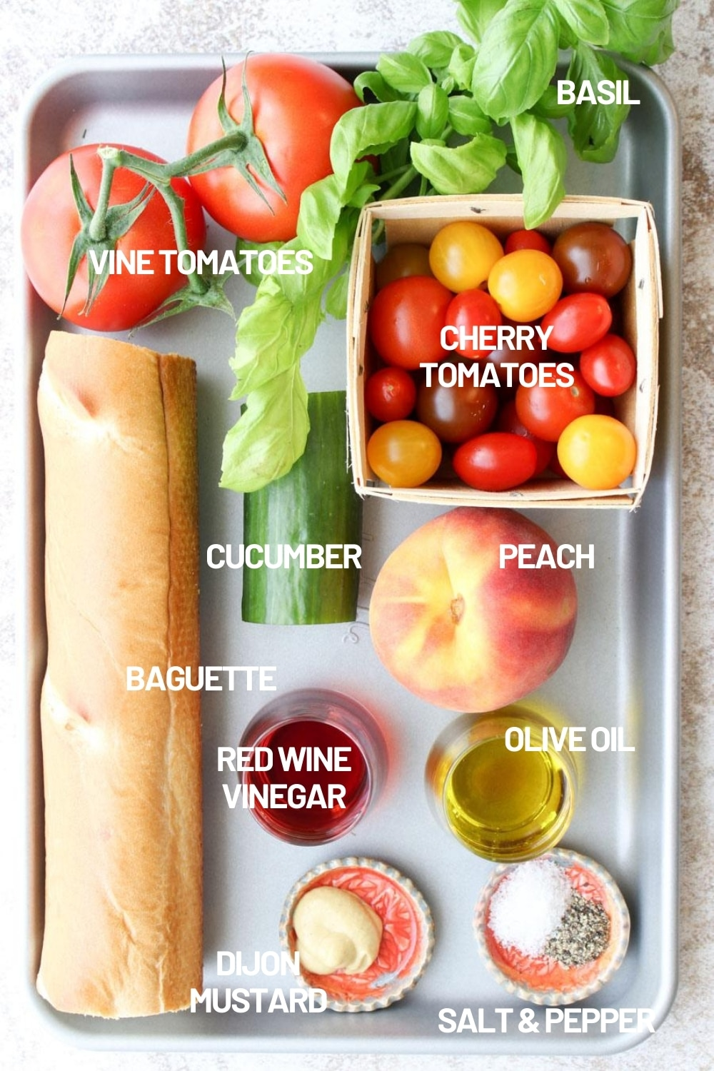 A try with all of the ingredients to make panzanella salad