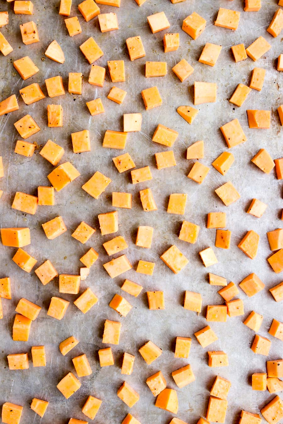 Diced sweet potatoes on a cookie sheet