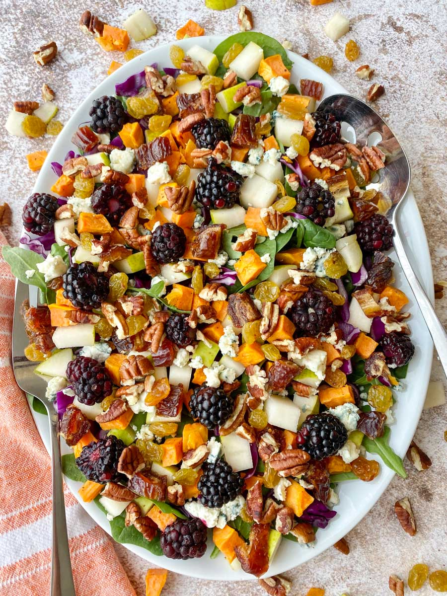 White platter with a colorful fall salad