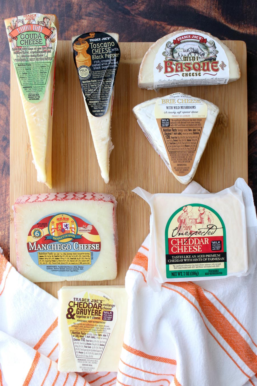 Seven types of cheeses in their packaging