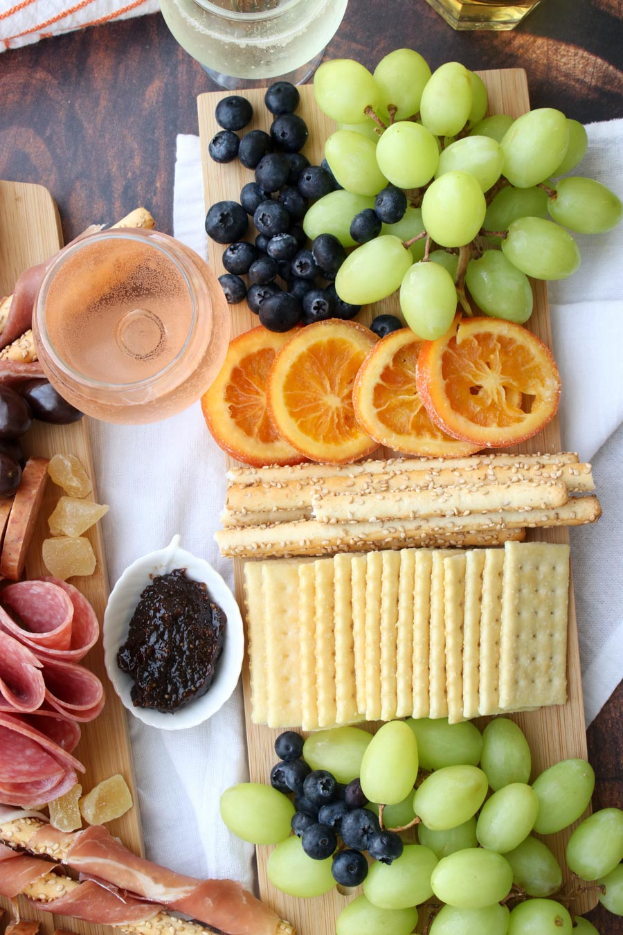 platter of crackers and fruit with wine