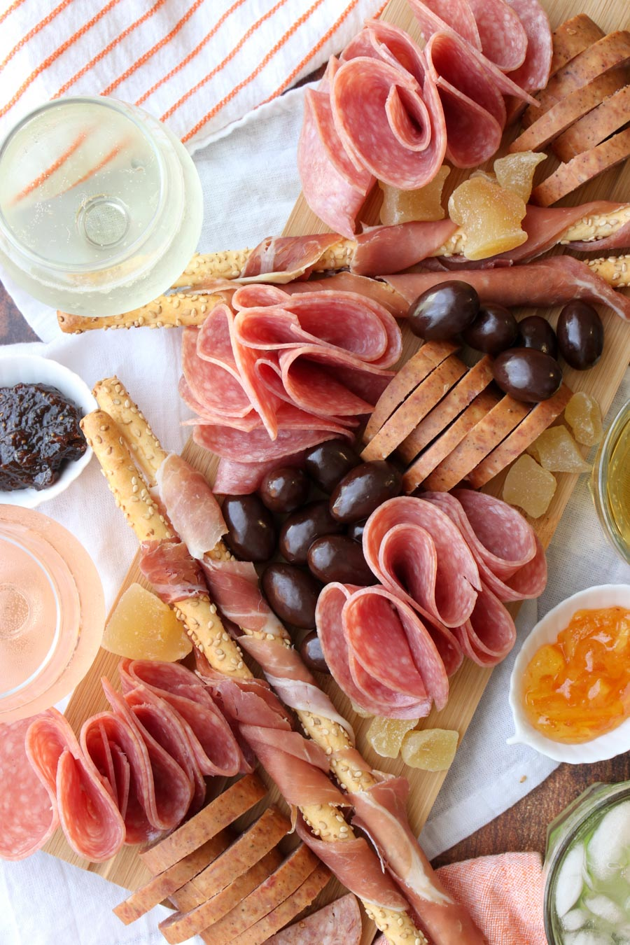 platter of meats and crackers with wine