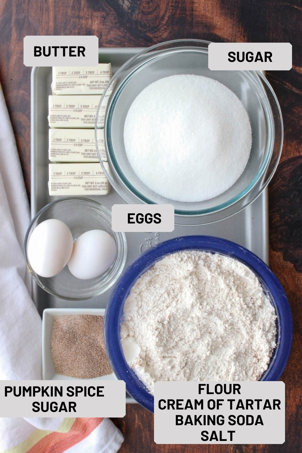 cookie sheet with the ingredients for making snickerdoodle cookies