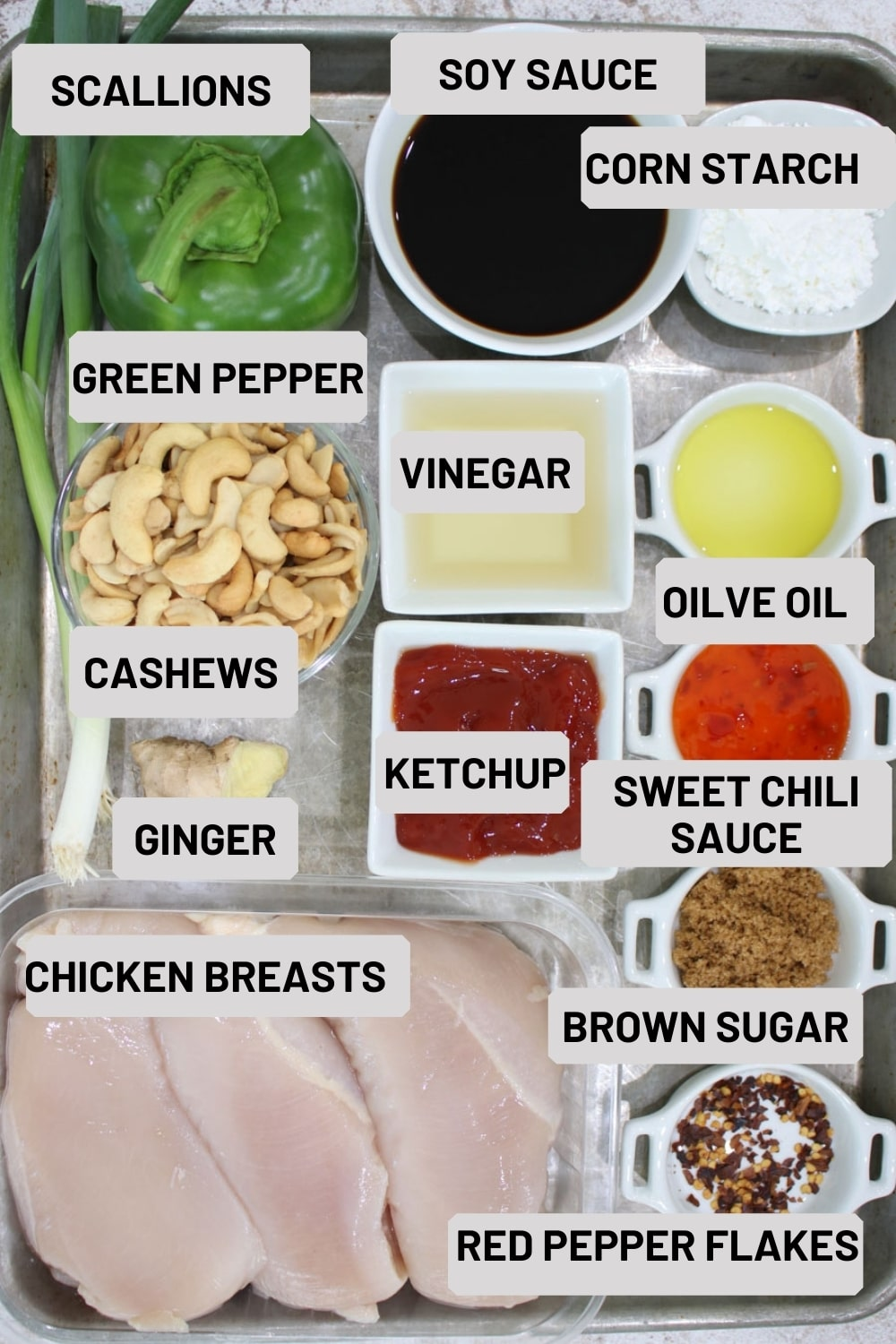 cookie sheet with the ingredients to make slow cooker cashew chicken
