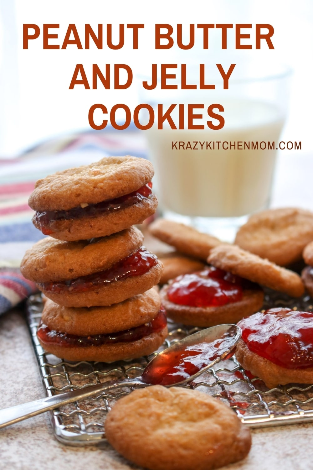 Two peanut butter cookies sandwiched together with grape jelly make the best Peanut Butter and Jelly Cookies.Crunchy, creamy, sweet - everything you remember in a delicious little three-bite cookie. via @krazykitchenmom