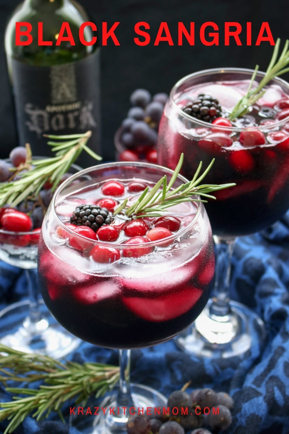 A fun, bold, and fruity sangria dressed up for Halloween. Black Sangria is a real crowd-pleaser. It's easy to make and it's great as a signature party cocktail.  via @krazykitchenmom