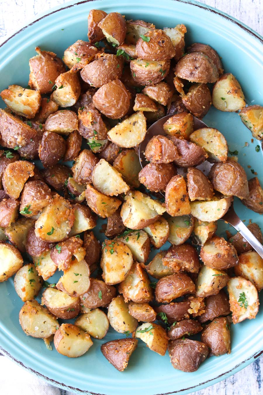 a turquoise plate full of roasted potatoes
