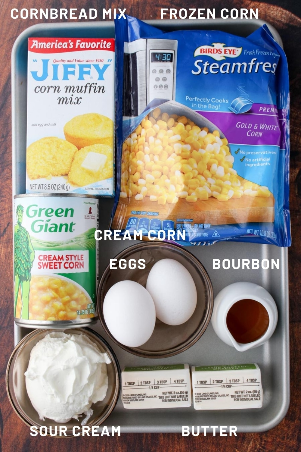 cookie sheet with all of the ingredients needed to make corn pudding