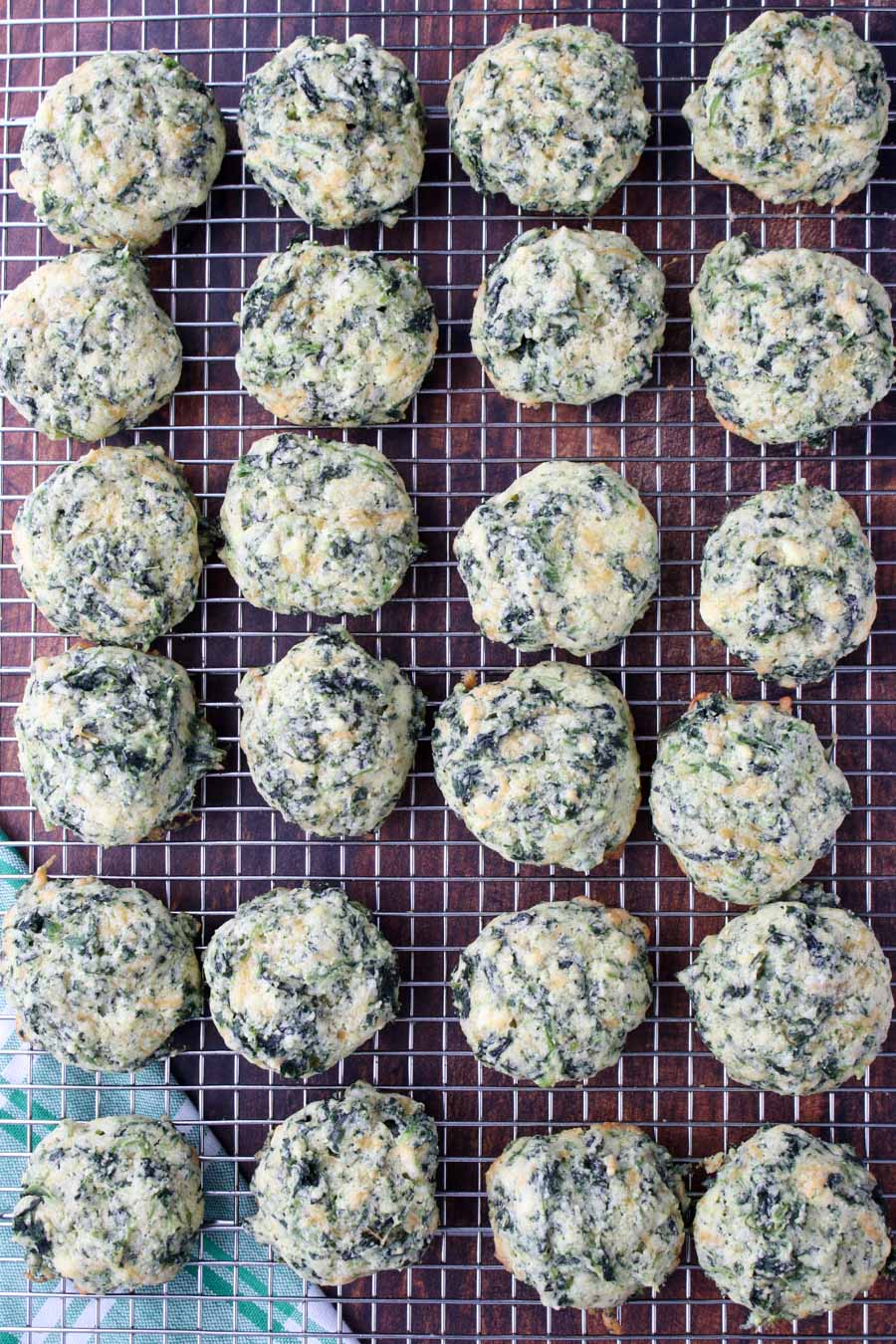 Spinach cheese bits on a cooling rack
