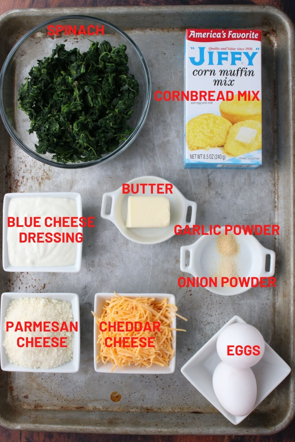 Cookie sheet with all of the ingredients to make spinach bites