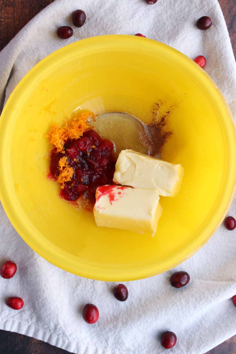 Cranberry butter ingredients in a yellow bowl