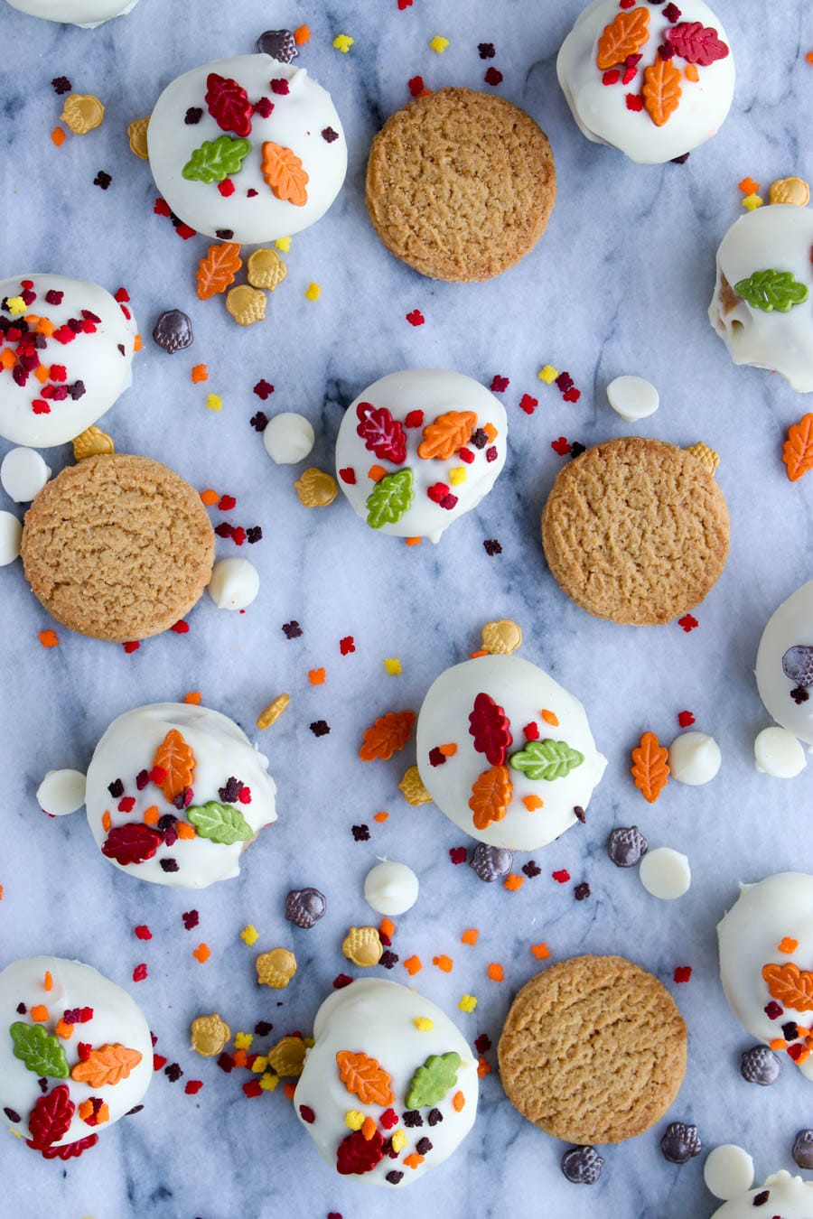 Cookies and sprinkles spread out on a marble background