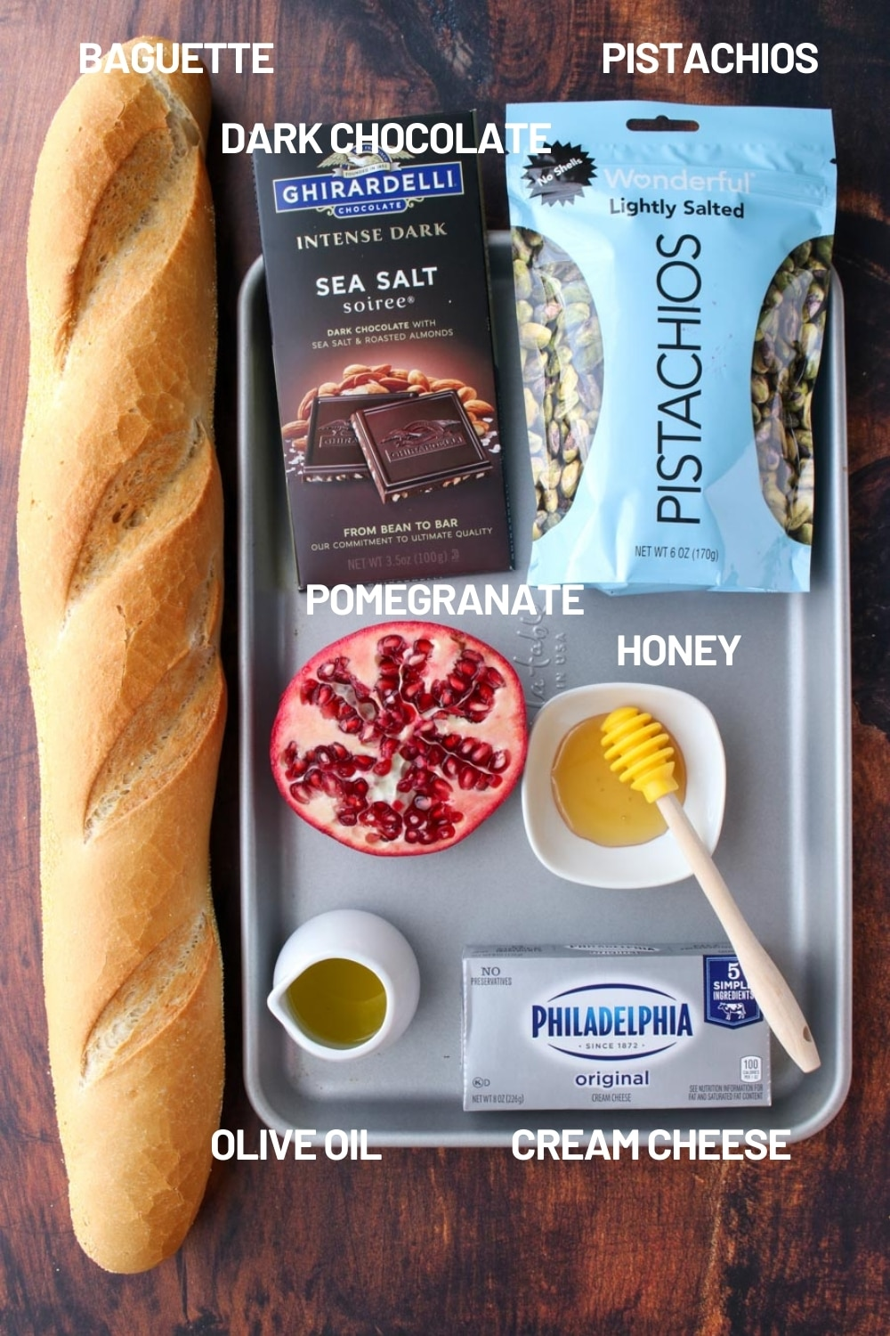 Cooking sheet with the ingredients to make Pistachio Pomegranate Crostini