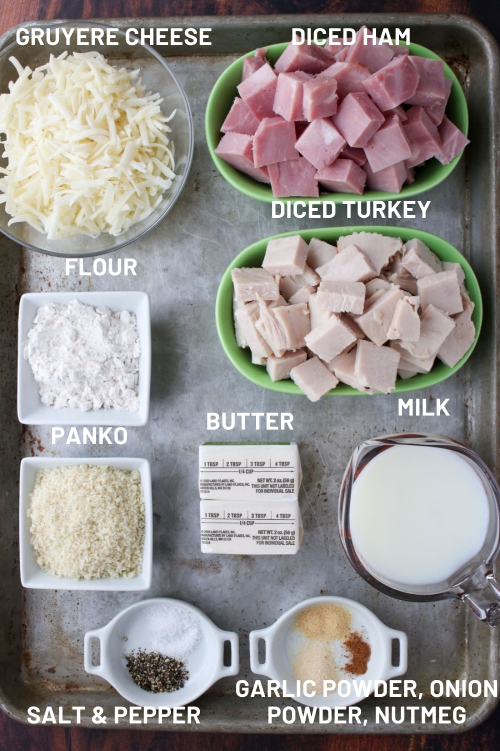 Cookie sheet with the ingredients to make turkey condon bleu casserole