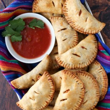 basket of empanadas and a bowl of salsa