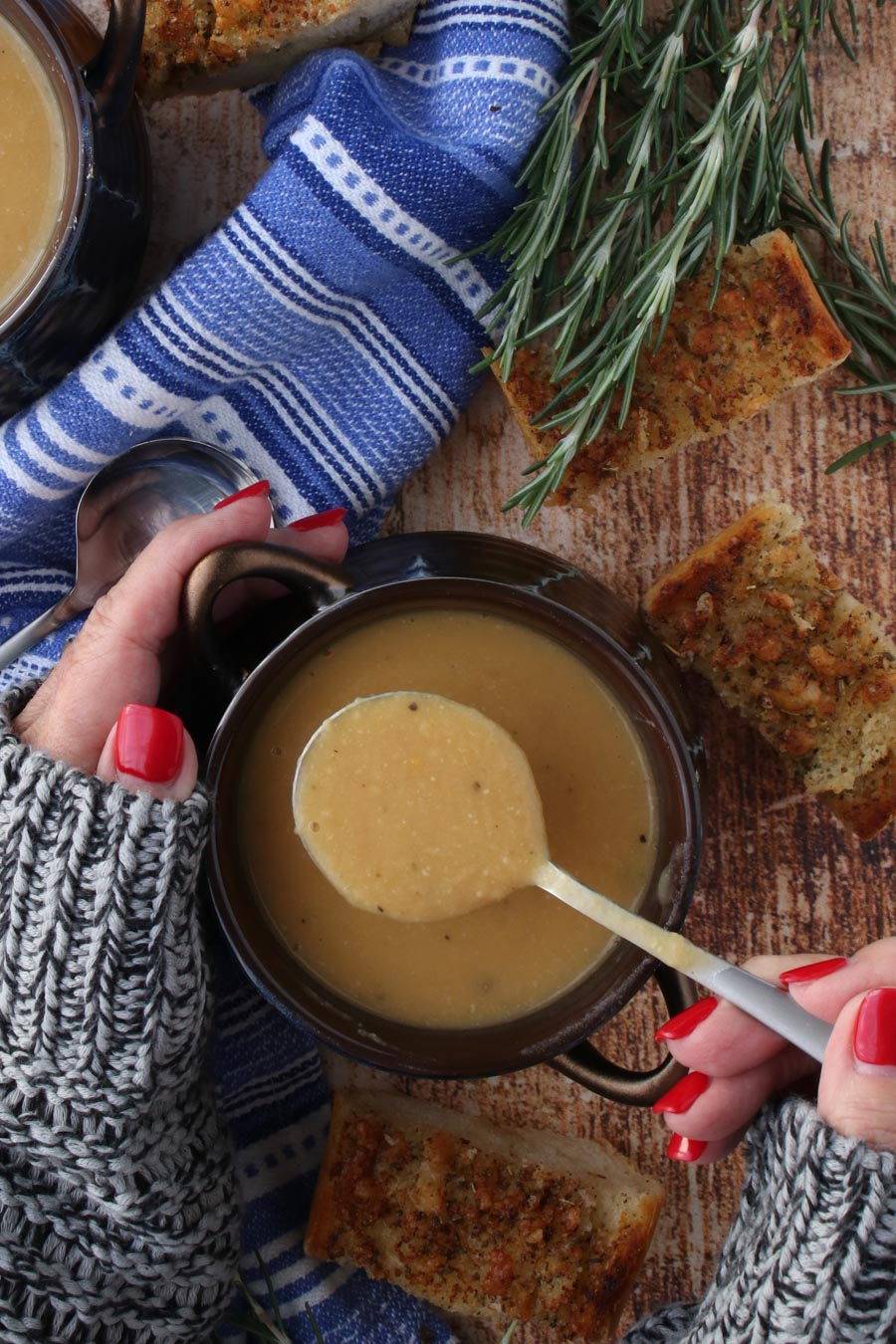 Woman's hands holding a bowl of bean soup