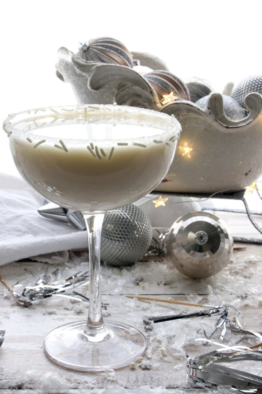white chocolate martini with a sparkling sleigh in the background