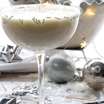 White martini with a glittery sleigh in the background