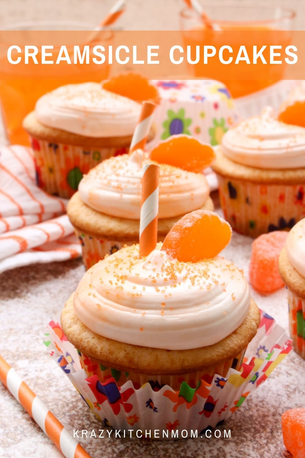 Soft, light, fluffy orange creamsicle cupcakes are made with orange soda pop and topped with creamy marshmallow frosting. via @krazykitchenmom