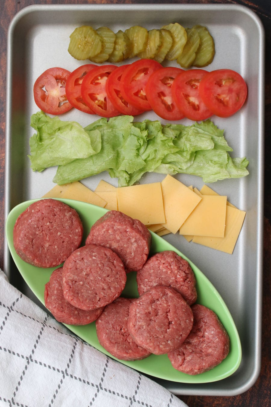 cookie sheet with the ingredients to make cheeseburger sliders