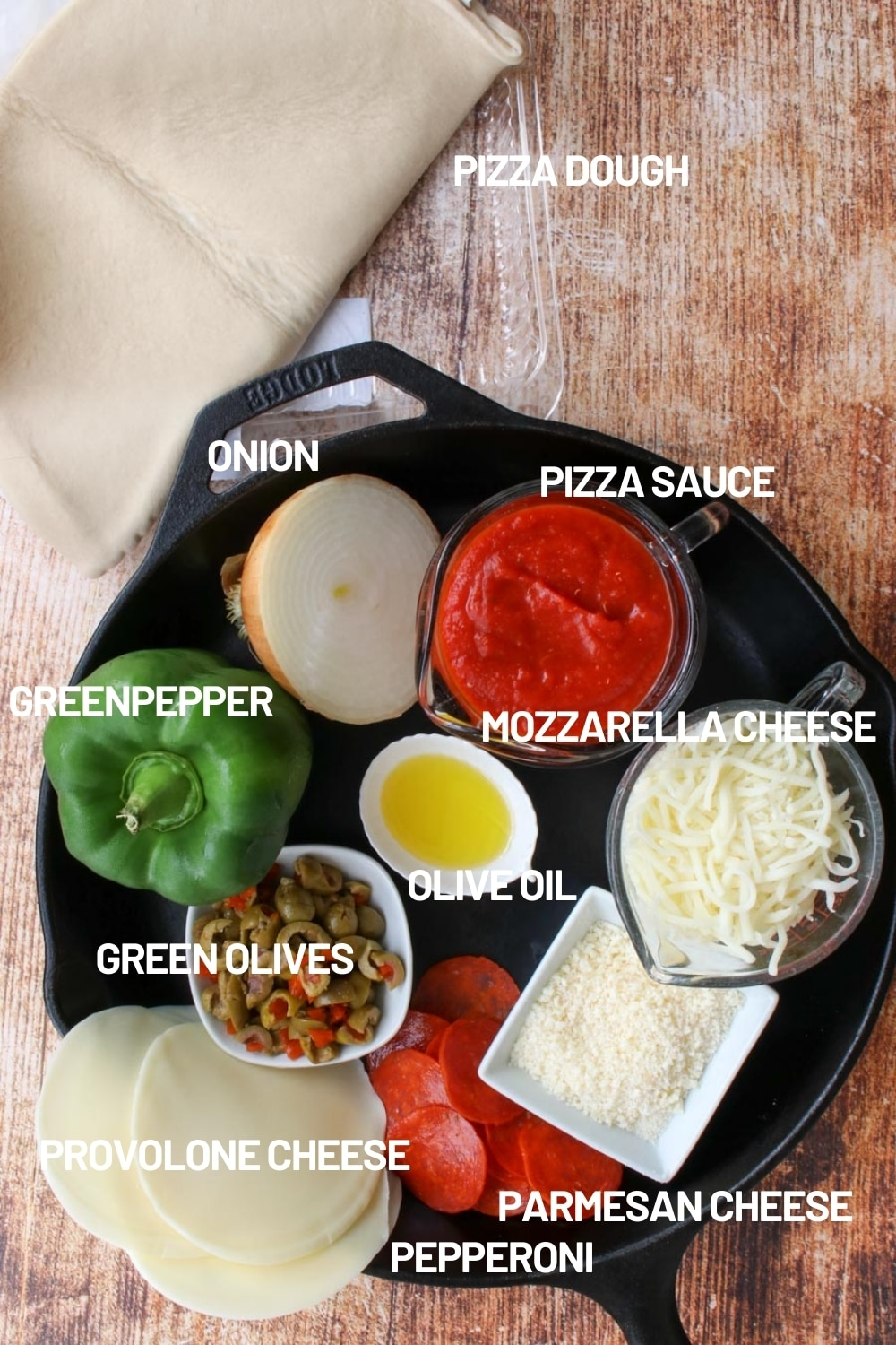 Skillet filled with pizza ingredients