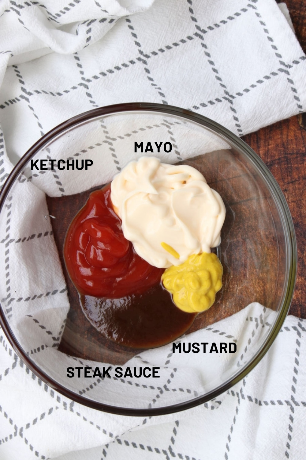 four ingredient for slider sauce in a clear glass dish