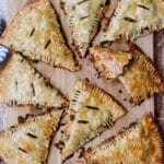 8 beef and potato hand pies on a cutting board