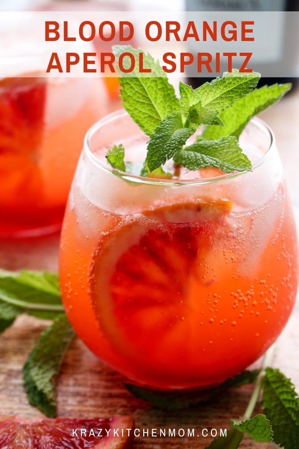 Blood Orange Aperol Spritz is a traditional Aperol Spritz made with blood orange juice and slices and then garnished with fresh mint. via @krazykitchenmom