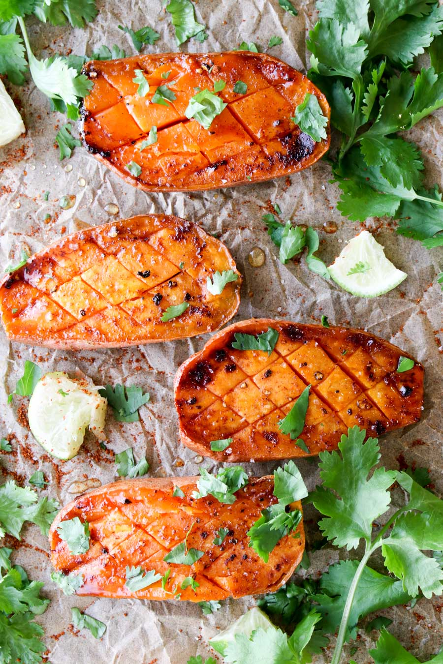 four roasted sweet potatoes with cilantro on top