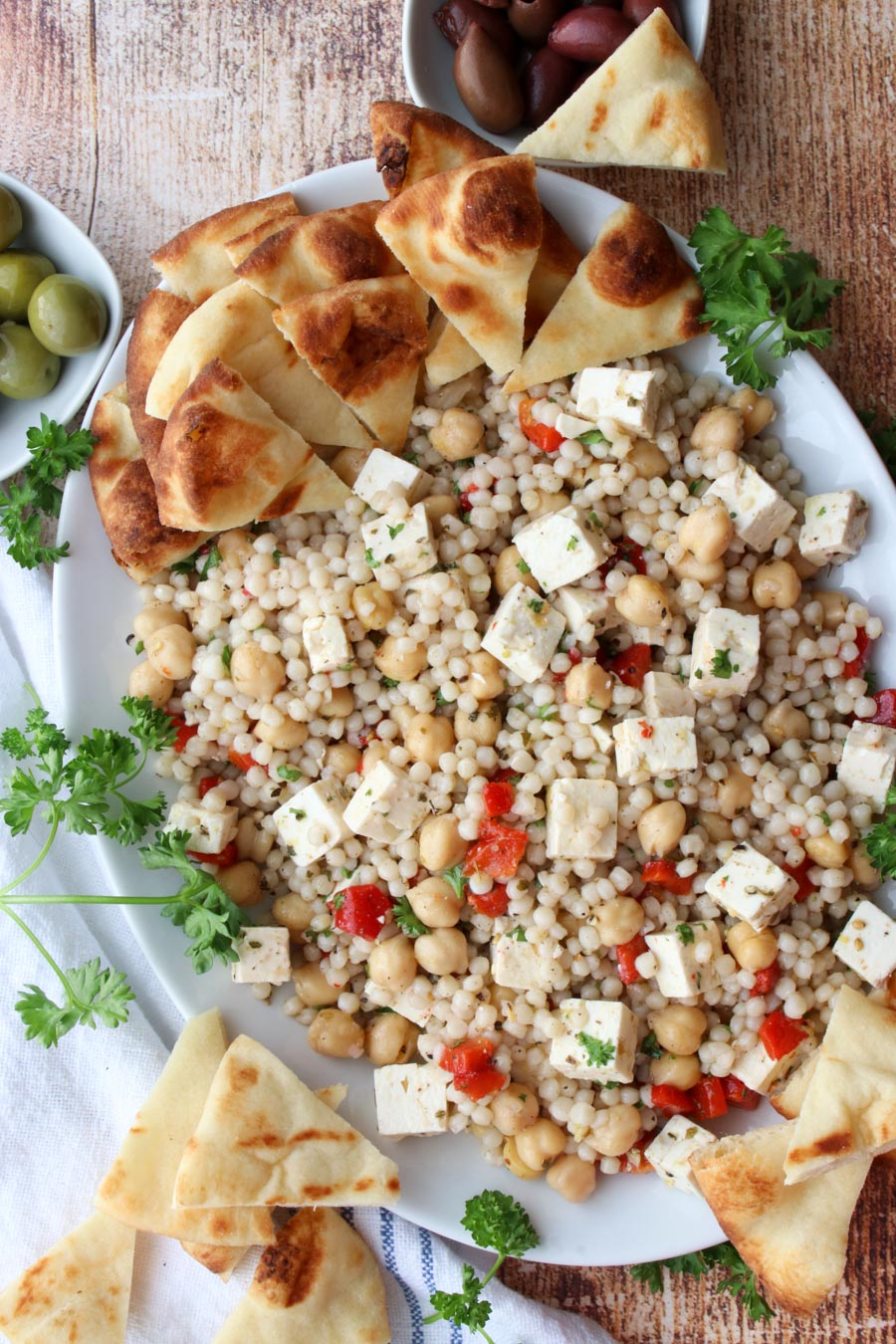 A platter of couscous salad  pita bread on the side