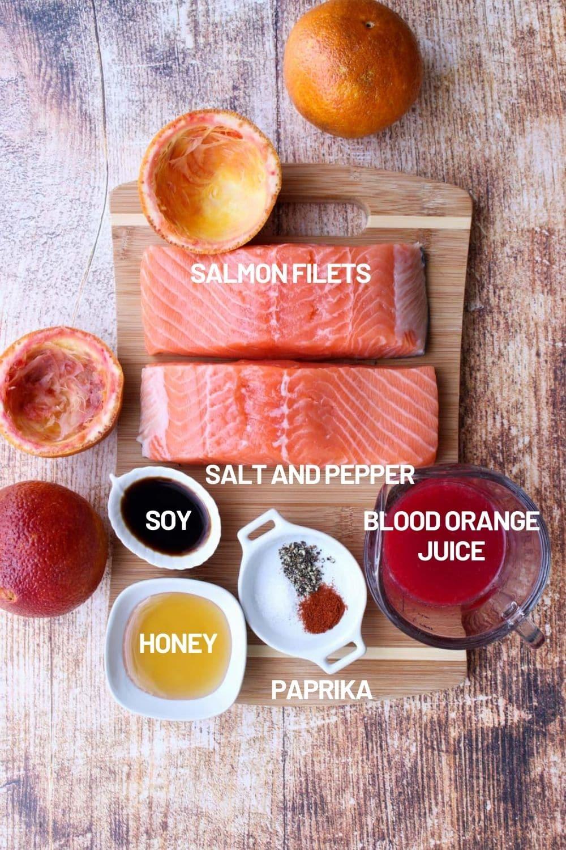 Cutting board with the ingredients to make orange glazed salmon
