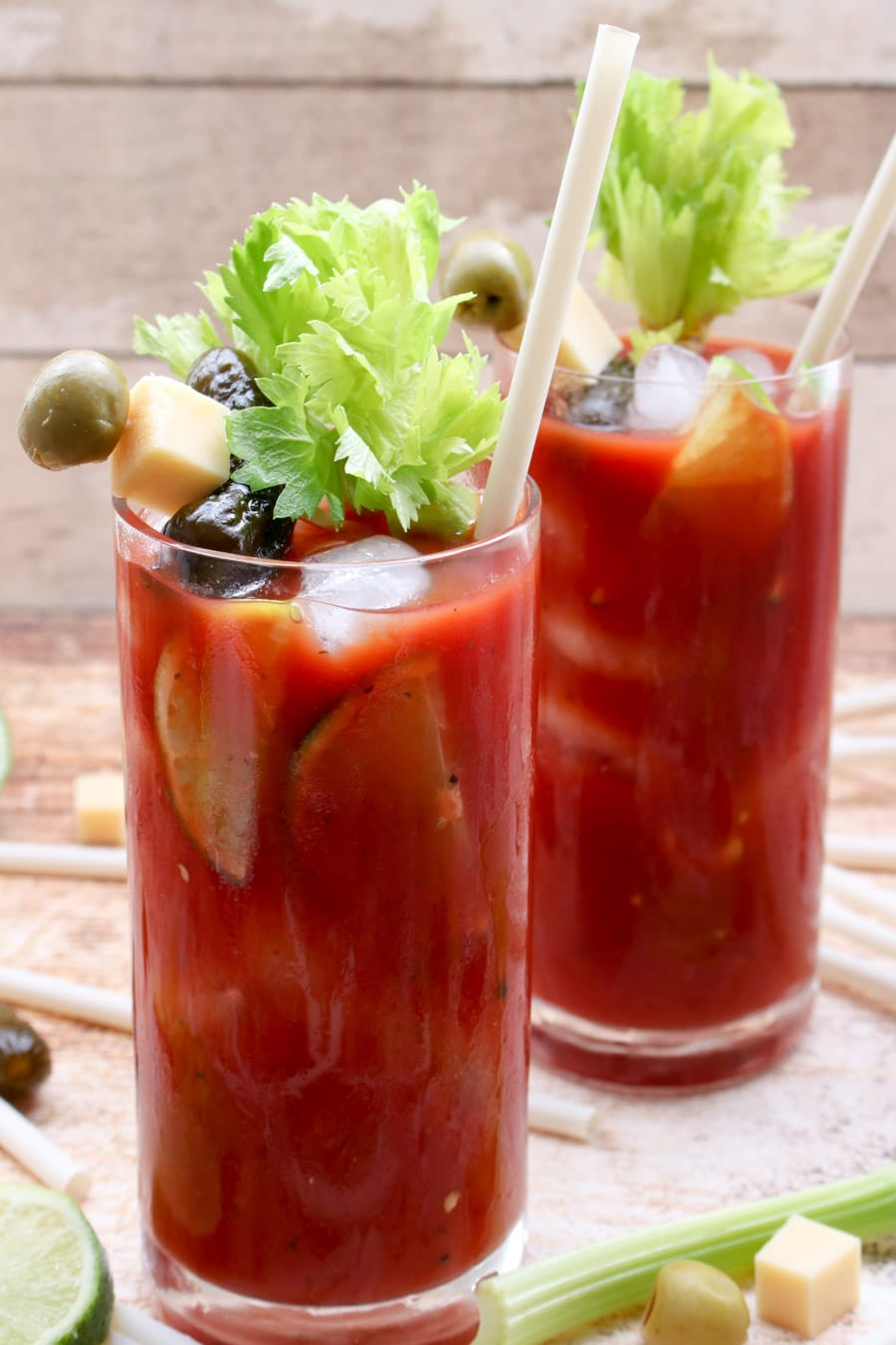 Two glasses of blood marys with celery stalks