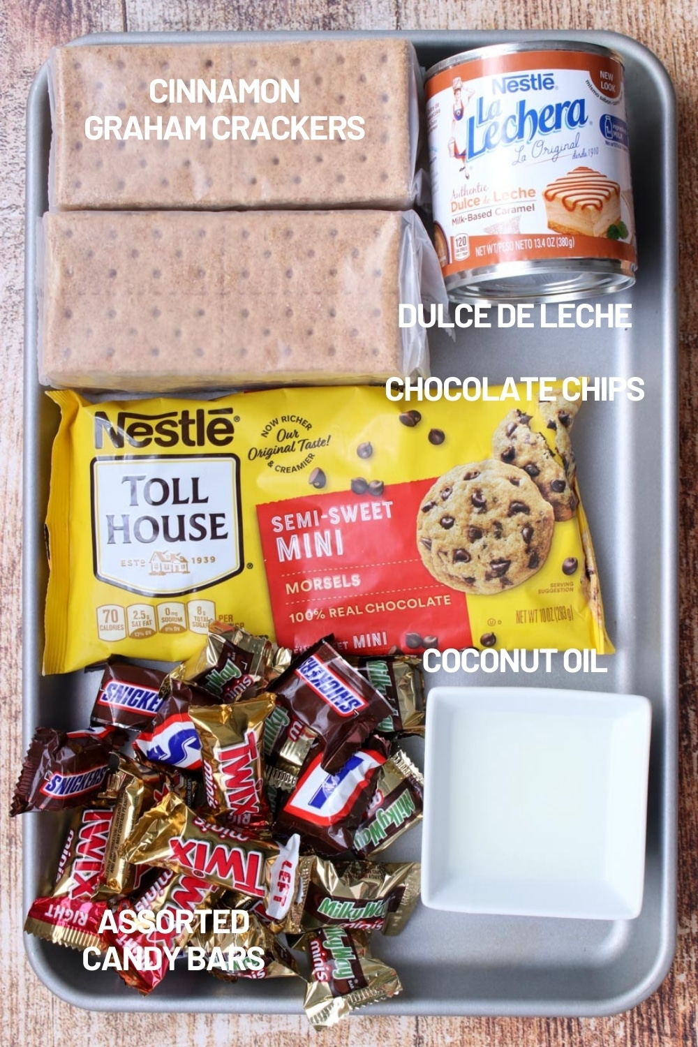 cookie sheet filled with ingredients to make chocolate caramel cookie bars