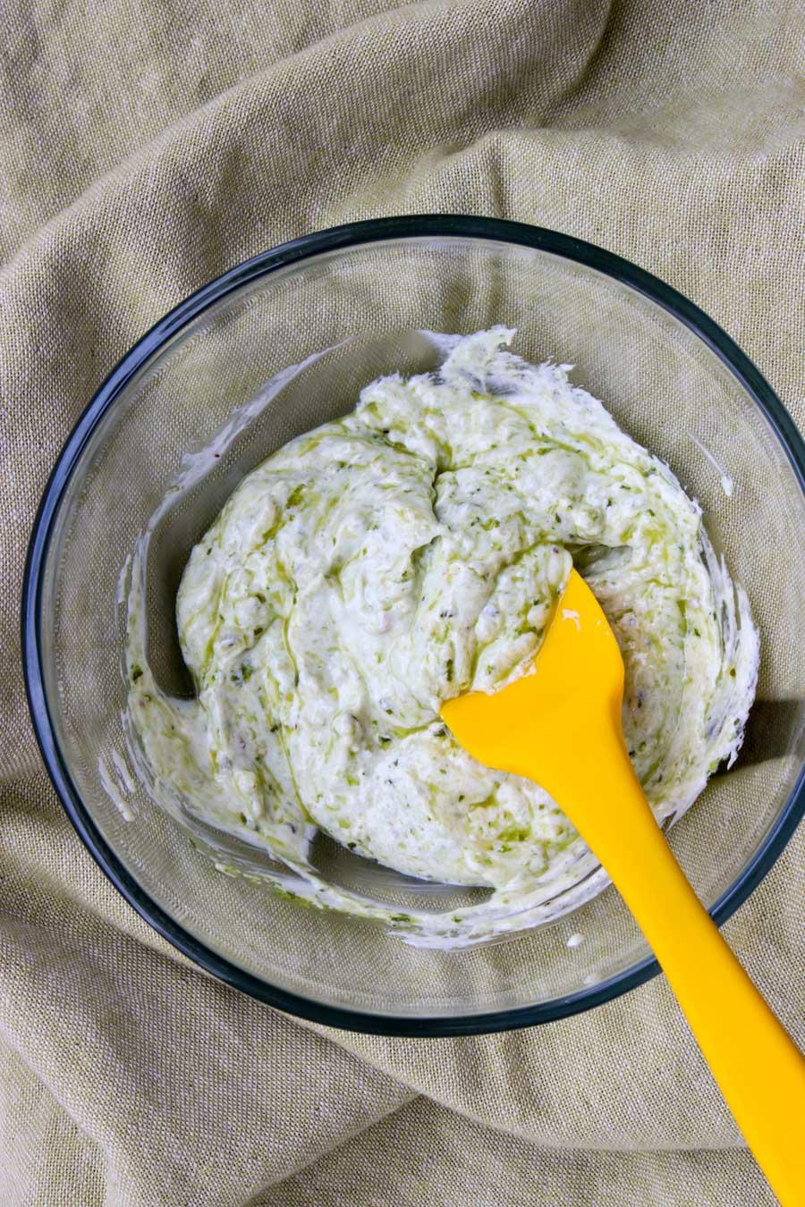 bowl of pesto yogurt dip with a yellow spook