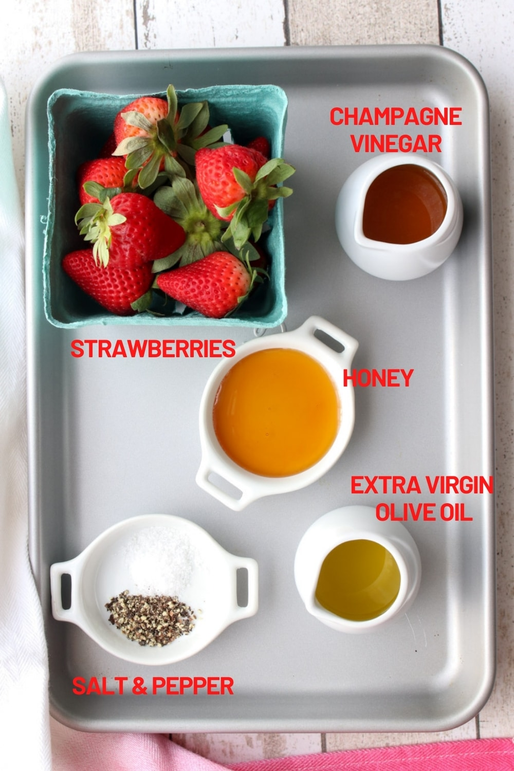 cookie sheet with the ingredients to make strawberry vinaigrette