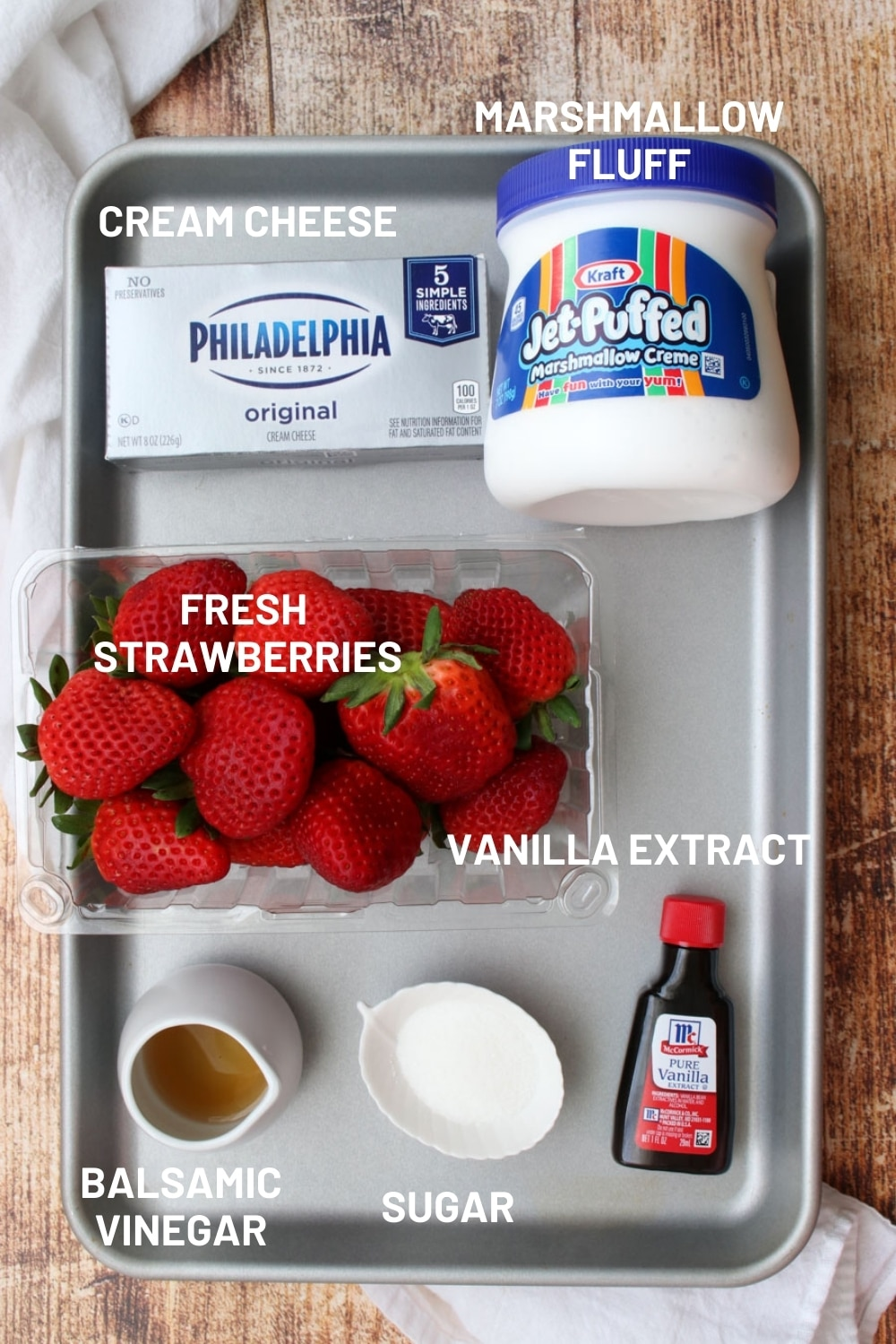 cookie sheet with the ingredient to make strawberry cheesecake dip