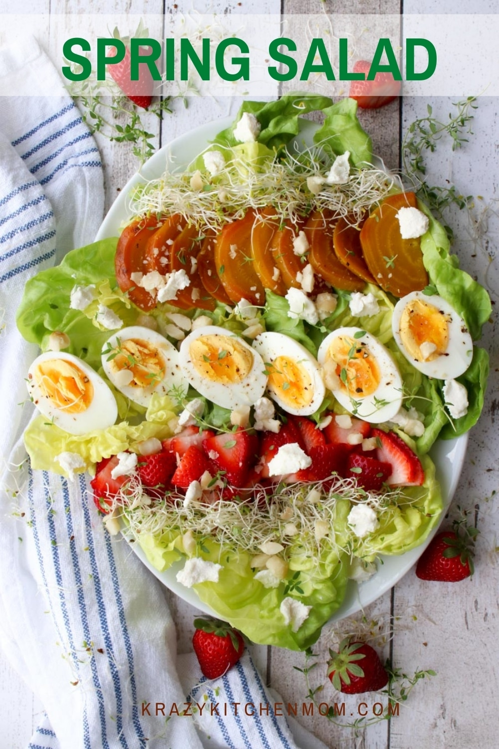 This fresh spring salad filled with soft crispy butter lettuce, strawberries, beets, hard-boiled eggs, and goat cheese will brighten any salad lover's day. via @krazykitchenmom